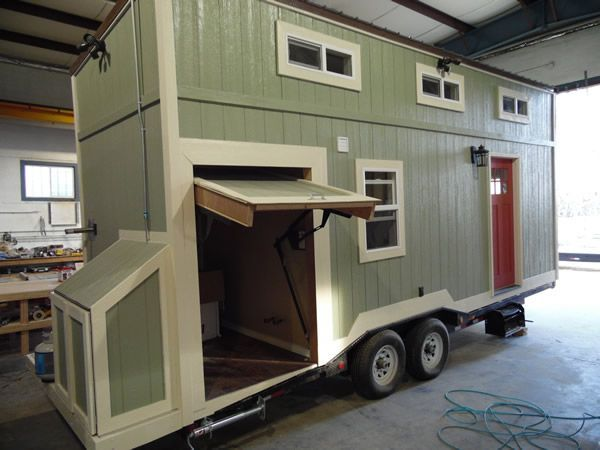 This is an 8′ x 24′ Toy Hauler tiny house for sale! From the outside, you'll notice green siding, a flat metal roof, and an orange-red door. When you go inside, you'll find …