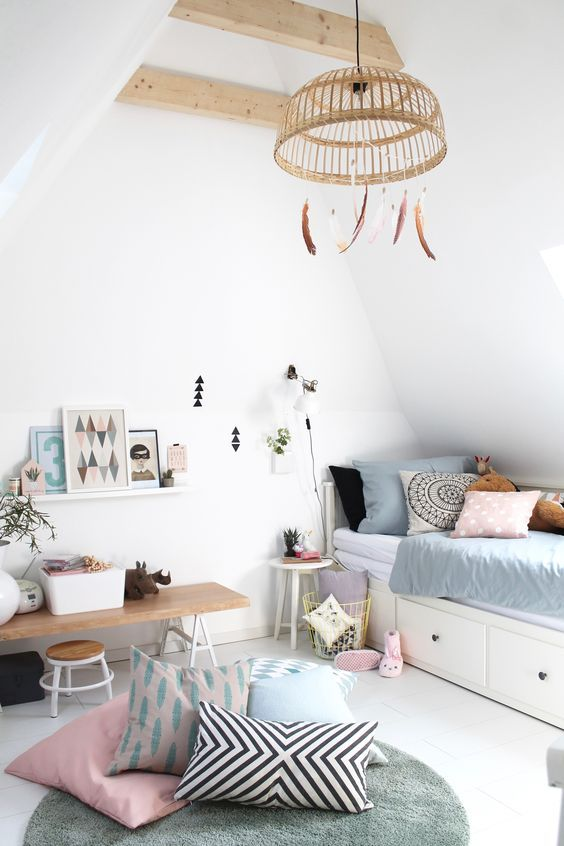 Boho chic little girls bedroom with feathers hanging from wicker light fixture