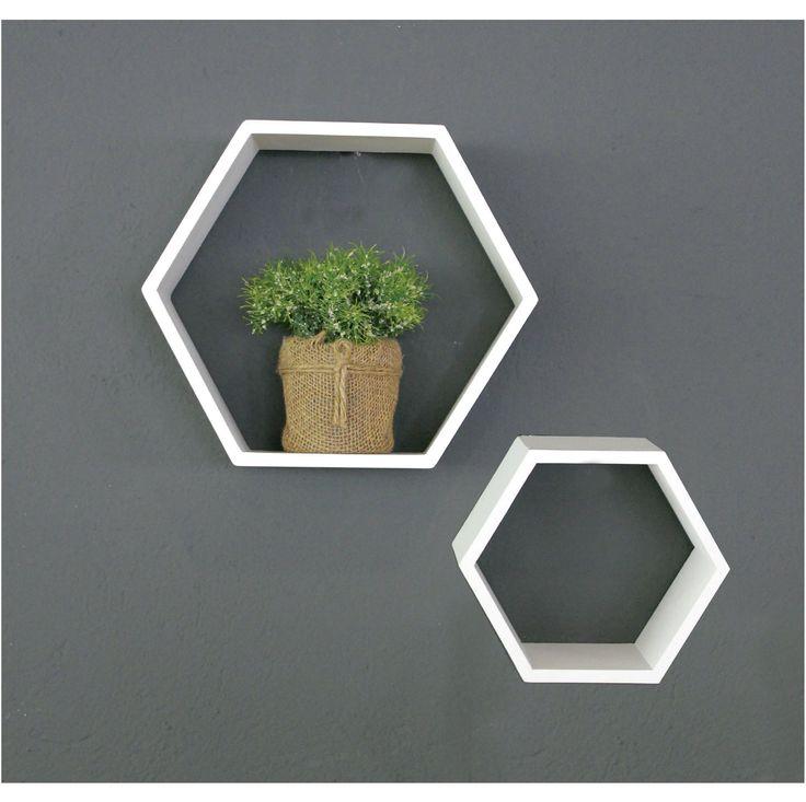 Perfecta combinación de una pared sobria con nuestras repisas hexagonales.