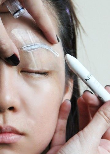 Shape your eyebrows with the help of an eyebrow stencil.  A step by step guide.