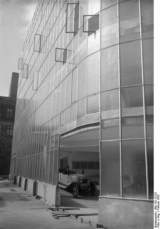 Kant-Garage, Berlin,In essence, a curtain wall system refers to a non-load-bearing exterior skin of a building, generally glass. While the earliest implementations of non-structural curtain walls date back to the mid 19th century, like 16 Cook Street in Liverpool, the practice continued to evolve, and was most notably embraced by architects in Germany's interwar period. Examples of interwar period German curtain wall systems include the Kant-Garage in Berlin and the Bauhaus Dessau. 1932.