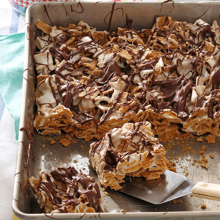Chocolaty S'mores Bars Recipe -One night, my husband had some friends over to play poker and he requested these s'mores bars. They polished off the pan and asked for more! I shared the recipe,and now their families make them, too. —Rebecca Shipp, Beebe, Arkansas