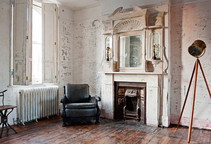 It feels so Parisian to me with the exposed radiator and white walls and shuttered windows.