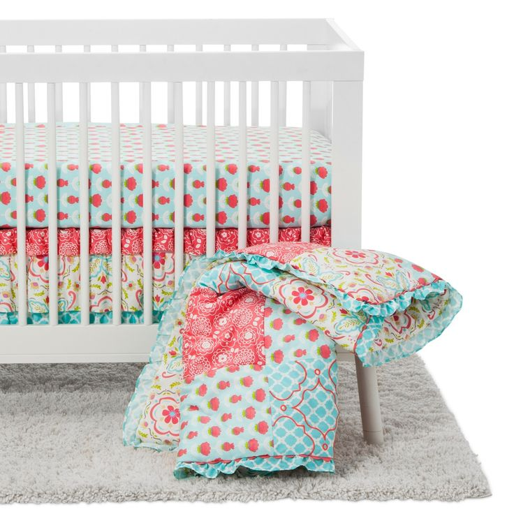 The Peanut Shell Mila four piece crib bedding set features a traditional patchwork design in a combination of contemporary floral and graphic prints in a vivid colorway of aqua, white, green, and coral. Crib set includes a patchwork, embroidered quilt, layered dust ruffle, fitted sheet, and diaper stacker.  Dust ruffle and crib sheet are designed to fit a standard crib and mattress and diaper stacker can hold up to 36 diapers.  Made of soft, 100% cotton sateen, this delightful collection…