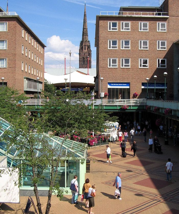 Coventry precinct with spire of ruined cathedral in the background.