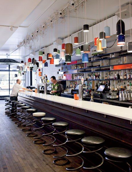 The bar at Parts & Labour restaurant, which occupies a former hardware-store space.