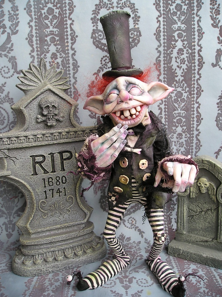 """While strolling through the cemetery I met a curious breed of fairy folk..... Graveyard Goblins!  This is """"Stench"""" A ghostly goblin that tunnels under graves, mixing coffins and confusing the nice folks at rest."""