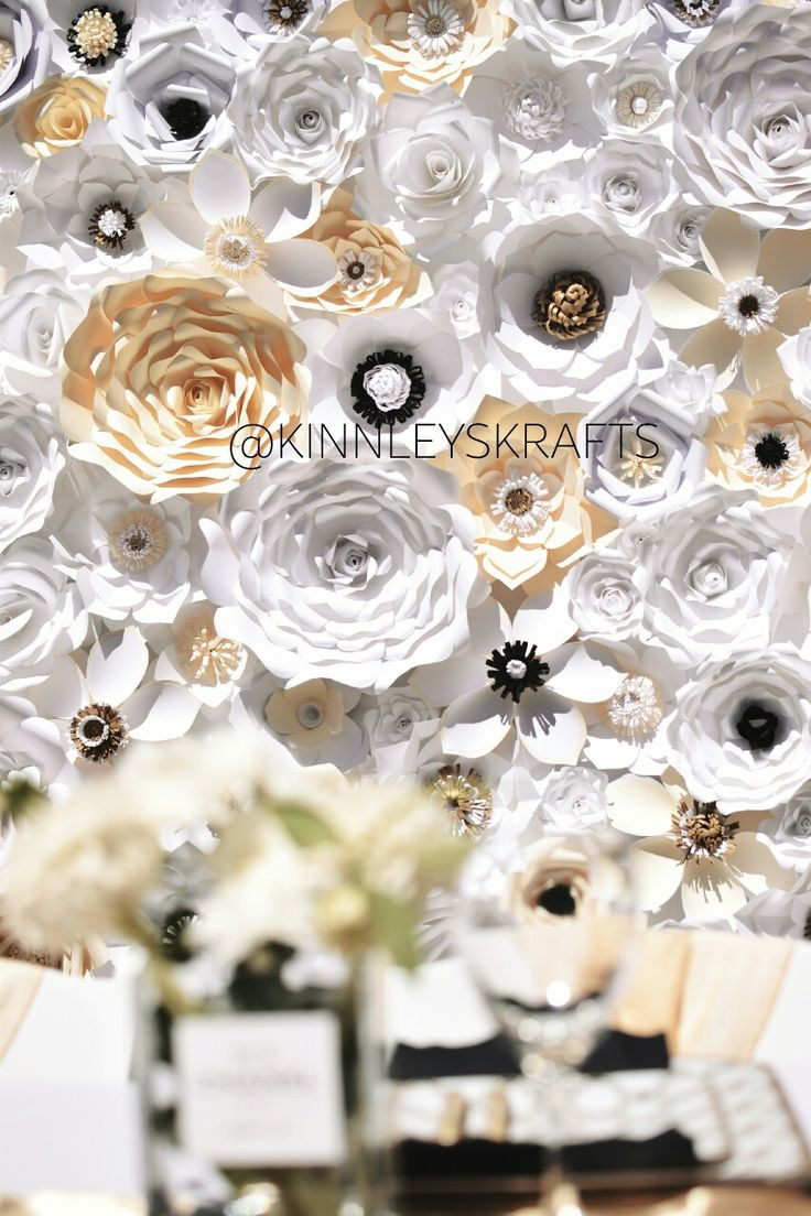 Black white and gold flower wall is the perfect backdrop for a Chanel themed bridal shower