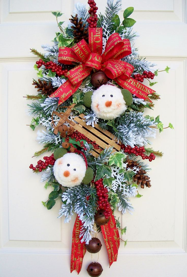 Snowball Snowman Swag for Christmas decorating. http://timelessfloralcreations.com/ https://www.facebook.com/timelesswreaths
