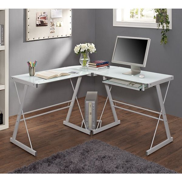 This contemporary desk offers a sleek, modern design crafted from powder coated steel and thick, tempered safety glass. The L-shape provides a corner wedge for space-saving needs with a look that is b