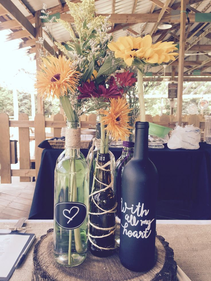 "Winery Bridal Shower - Spray painted chalkboard wine bottle, hand written ""love"" quotes - Fresh flowers from Trader Joes at an awesome price!"