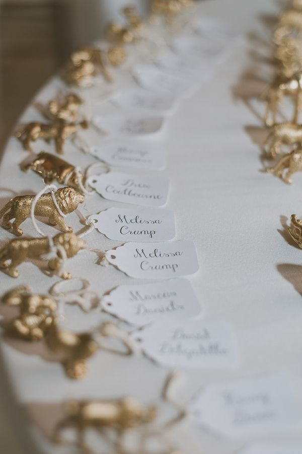 animal figurine escort cards, photo by Day 7 Photography http://ruffledblog.com/elegant-rancho-mirando-wedding #seatingchart #animalfigurines #wedding
