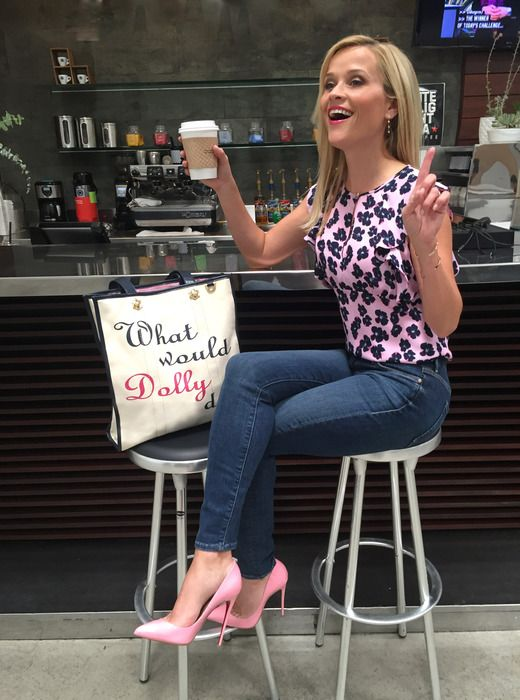 Reese Witherspoon drinks coffee and carries the What Would Dolly Do Draper James Tote Bag