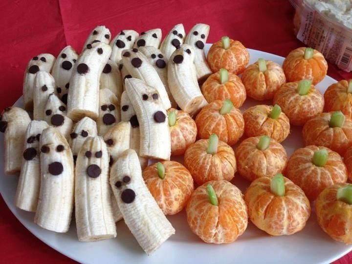 Delicious spooky treats Slice bananas in half add mini chocolate chip eyes and regular for mouths, peel oranges or tangerines and place a piece of celery stick in  the center and viola! curious hands will gobble them up.
