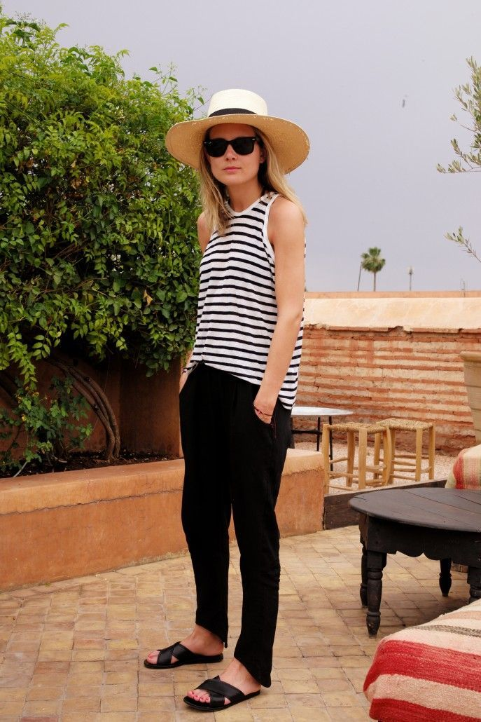 Summer style | black + white striped tank, criss cross black sandals + black summer pants with a summer hat + sunglasses