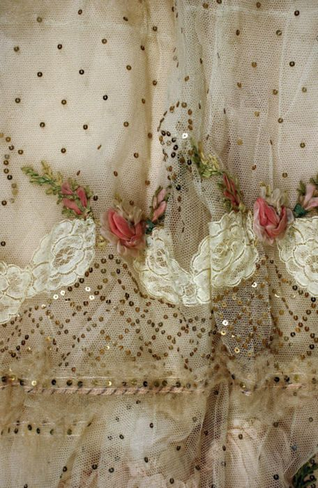 ornamentedbeing:    ca. 1899  Oh my goodness look at all those tiny little spangles and the tiny little ribbon roses. The detail on this dress is just so beautiful.