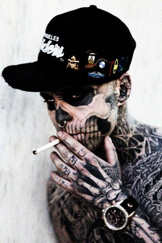 Rick Genest was born in Montreal Canada and when he was 15 years old he underwent a exploratory surgery to remove a brain tumour. The doctor told him he had a 1 in 3 chance of living through the surgery, needless to say luck was on his side. Rick got his first tattoo at the age of 16 and then moved out of his parents house at the age of 17. At the age of 21 he met Montreal tattoo artist Frank Lewis and there he began his journey to transform him self into a walking, real life decomposing…