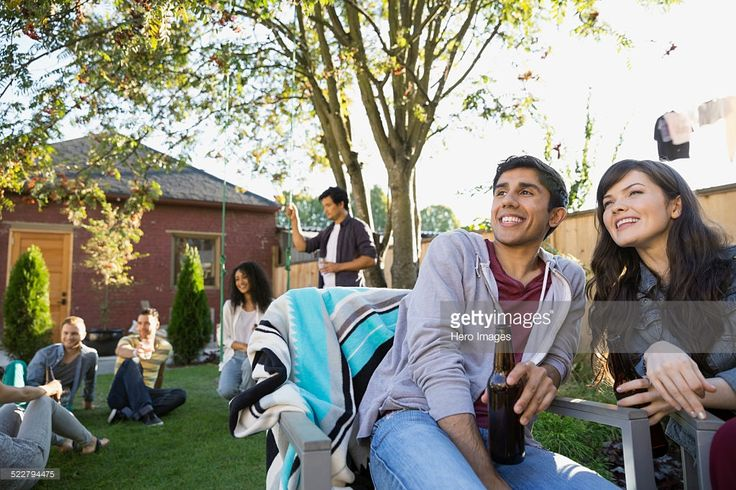Stock Photo : Friends hanging out at backyard barbecue
