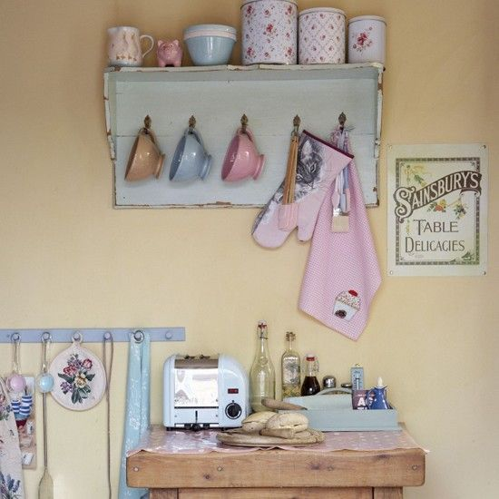 Make the most of your pretty cookware and display crockery in similar shades on open shelving