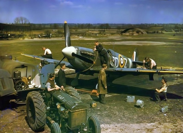 Spitfire Mk.Vb at North Weald.  Groundcrew refuel Supermarine Spitfire Mark VB, 'ZD-Z', of No.222 Squadron RAF, from a tractor-towed petrol bowser, while armourers replenish its .303 machine guns, at North Weald, Essex.