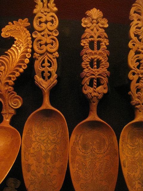 Carved Swedish wooden spoons/ I like the decoration extending onto the bowl of the spoon.
