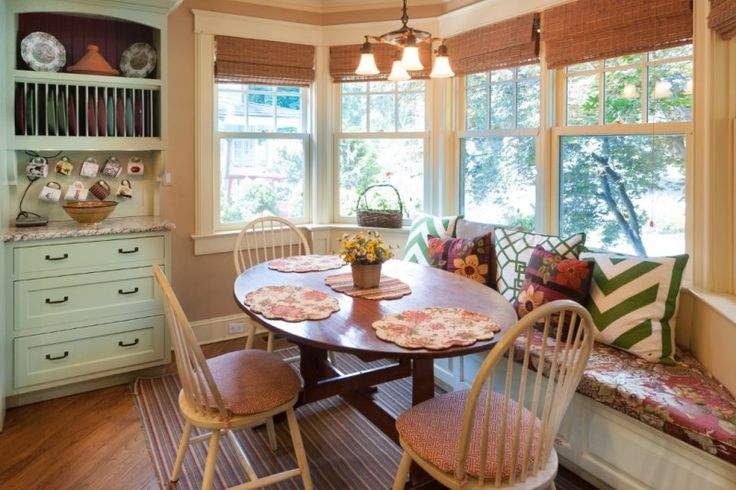 Cozy kitchen nook with banquette in bay window. A Lovely Old Lake House For Sale in Connecticut - Hooked on Houses