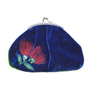 With its darling vintage-style clip this velvet coin purse is adorned with our feminine take on a Kiwi flower – the Pohutakawa. Hand-embroidered leaves, sparkling, sequinned stem and oh-so gorgeous beading on the very tips of the flowers, this purse is sure to delight.
