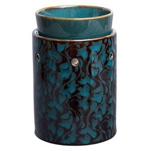 A secret garden of swirling teal and bronze leaves creates a lush, organic accent for any room. To purchase, go to www.jenni.scentsy.com.au
