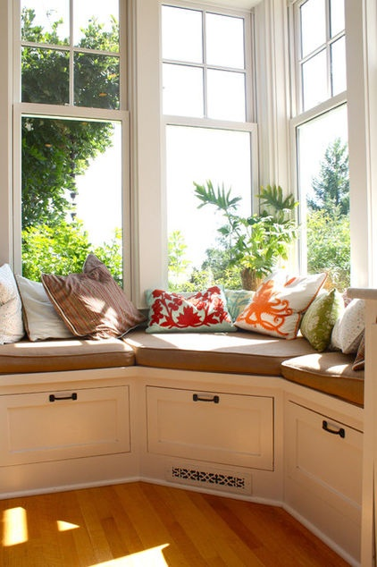 the warm and sunny window seat in the kitchen is a favorite spot for reading the newspaper, checking emails and simply enjoying the view.