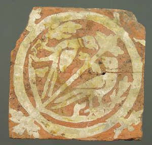Medieval floor tile from Neath Abbey. This item comes from: National Museums & Galleries of Wales (Item reference: 63.469/19).    This tile, produced around 1340, shows two birds feeding from a central stem. Tile size: 154 x 152mm.