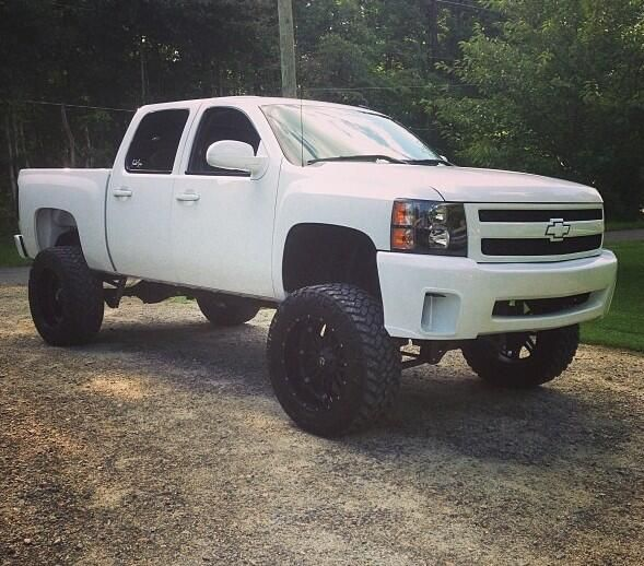 white Chevrolet lifted truck