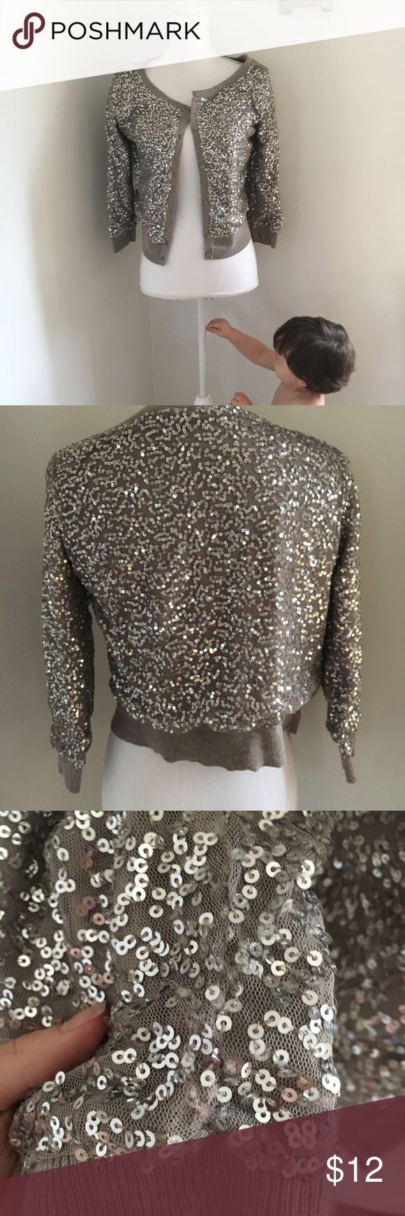 American Eagle sequin cardigan Gray American eagle sequin cardigan. Fair condition, may be a few loose strings or fuzzy. Still adorable American Eagle Outfitters Sweaters Cardigans