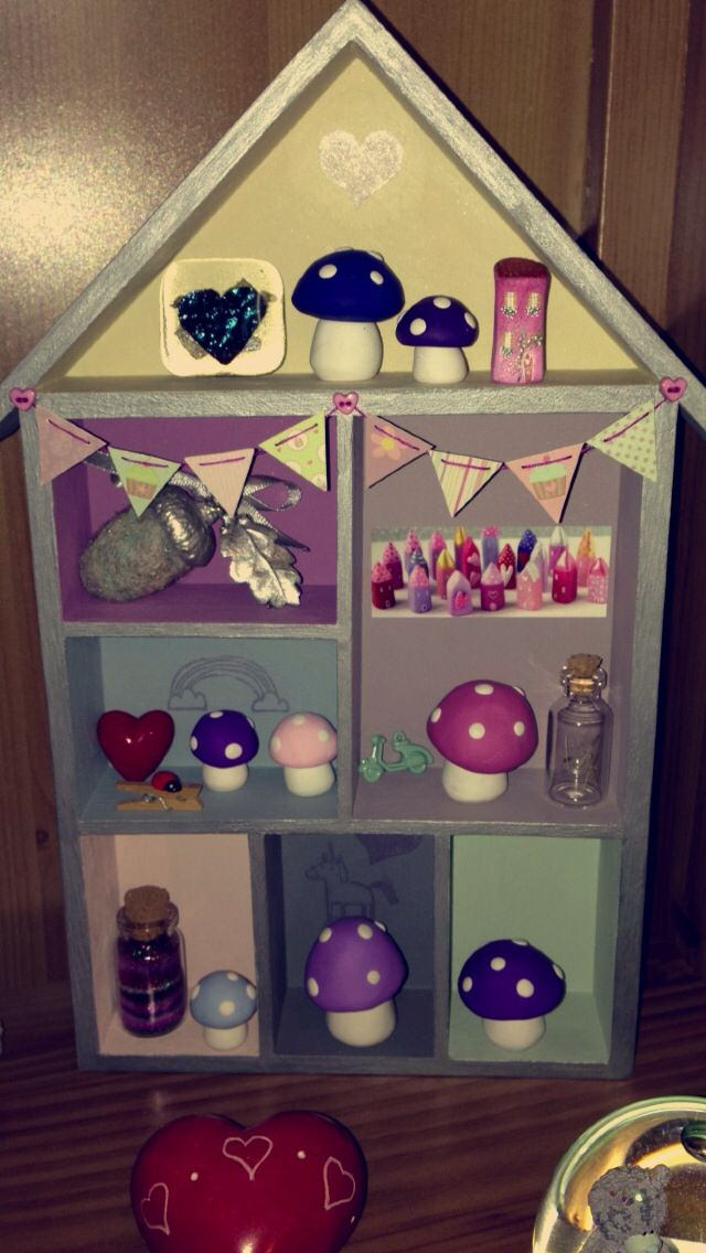 My tiny wooden house painted & tiny bunting made by me, filled with awesome tiny pretty things! x