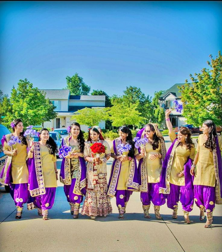 Sikh Punjabi bride with bridesmaids in purple suits. Wedding