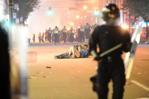 Love blossoms in the middle of chaos: The riot kiss