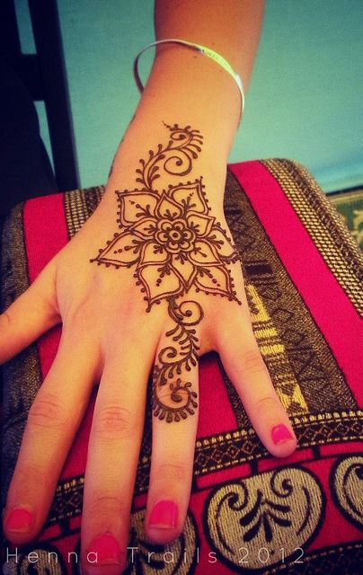simple henna design on hand