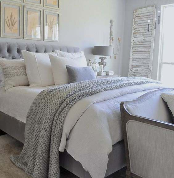 Gray And White Bedroom With Tufted Headboard