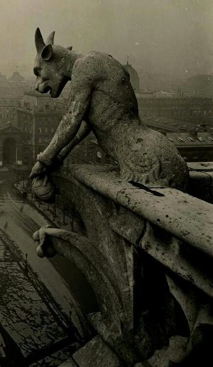 (Chapter 9) A Grotesque is a mythical beast with fangs or wings. They were designed to scare away evil spirits. They were often known as gargoyles and could sometimes be unicorns, lions, or a griffin. They are seen on the Notre Dame in Paris.