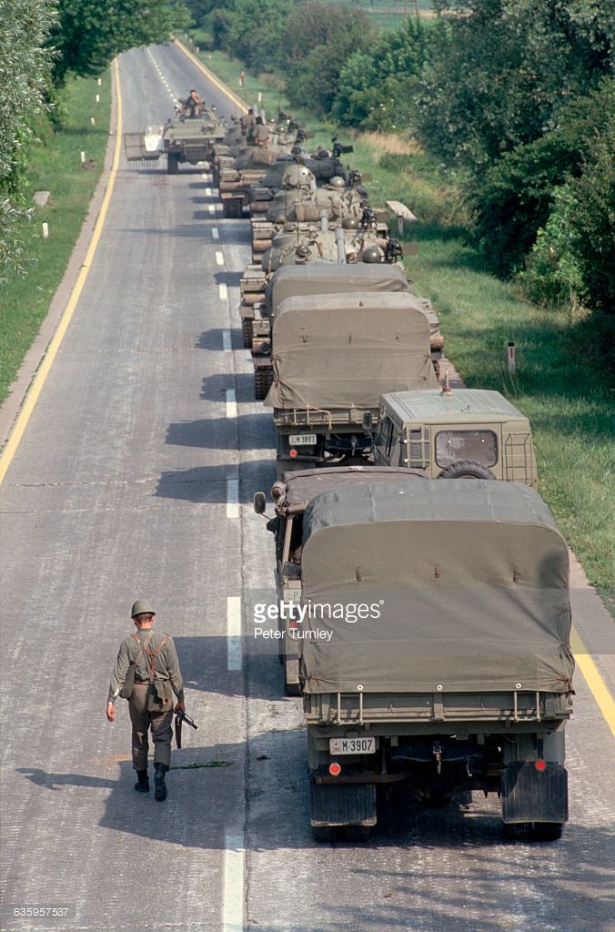A Convoy Of Yugoslavian Federal Army Tanks And Trucks Sits On A Army Tanks Army Army Vehicles