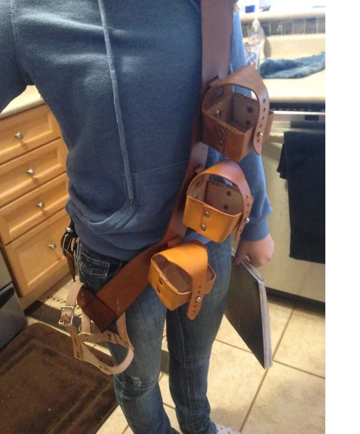 Camera Bandoleer with lens holders and camera holster.