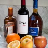 For basic sangria, you need a bottle of red wine, some orange liquor, some brandy, and some fresh fruit.