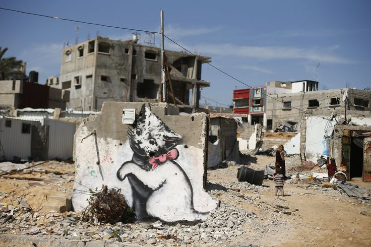 A mural is seen today on the remains of a house that witnesses said was destroyed by Israeli shelling during a 50-day war last summer in Biet Hanoun town in the northern Gaza Strip.