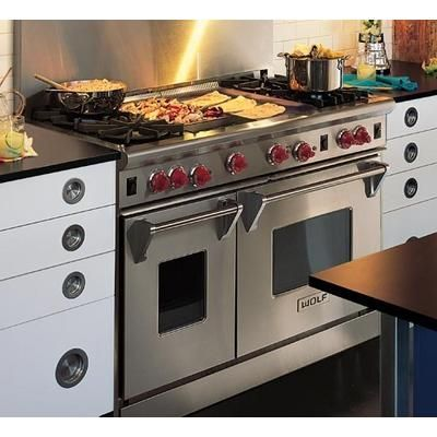 this is the stove/oven that i want! griddle, grill, gas, small oven and large oven. perfect!