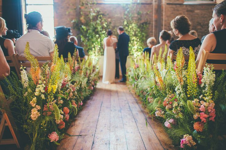 Vibrant Floral Aisle | Laure de Sagazan Wedding Dress | Colourful Wedding At Paintworks Bristol | Flowers By The Rose Shed | Images From Matt Willis Photography | http://www.rockmywedding.co.uk/rachel-alex-3/