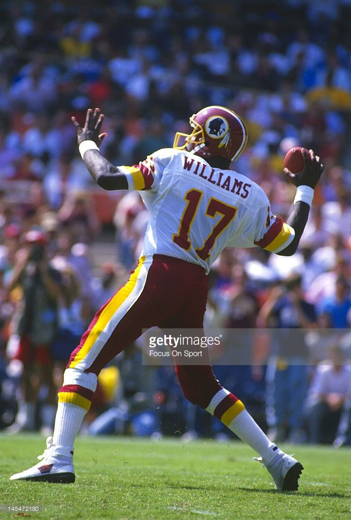 1977 Washington Redskins | Quarterback Doug Williams #17 of the Washington Redskins drops back to ...