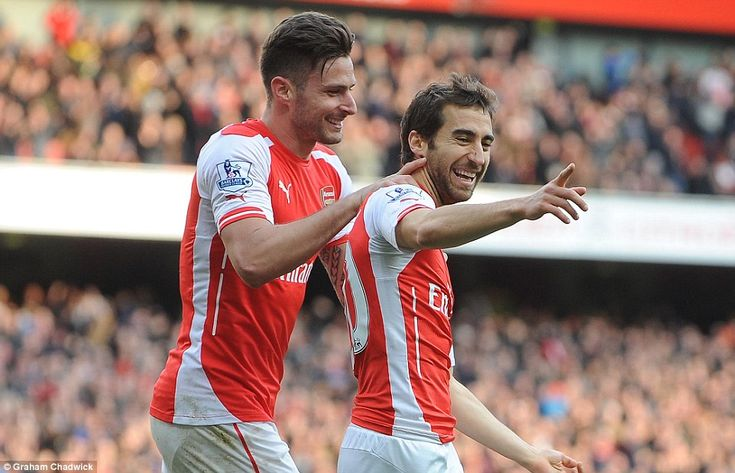 Giroud gives substitute Mathieu Flamini a pat on the back after the Frenchman seals victor...