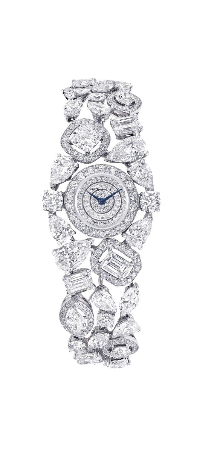 Graff Diamonds Celestial Watch - Over 29 carats of multi-shape diamonds surround a face with a pavé diamond dial.  Graff Diamonds, Price Upon Request