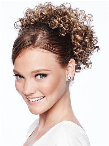 Cheer Dance Curls by POP, HairDo:   Every twirl needs a little curls. These tight spiral curls will add some spring to every step. Reshape with your fingers or touch up the heat-friendly fiber with a curling iron. P-O-P in and GO curls, GO!