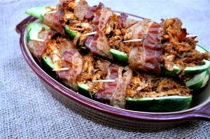 Bacon wrapped stuffed zucchini with shredded chicken! YUM! from fedandfit.com