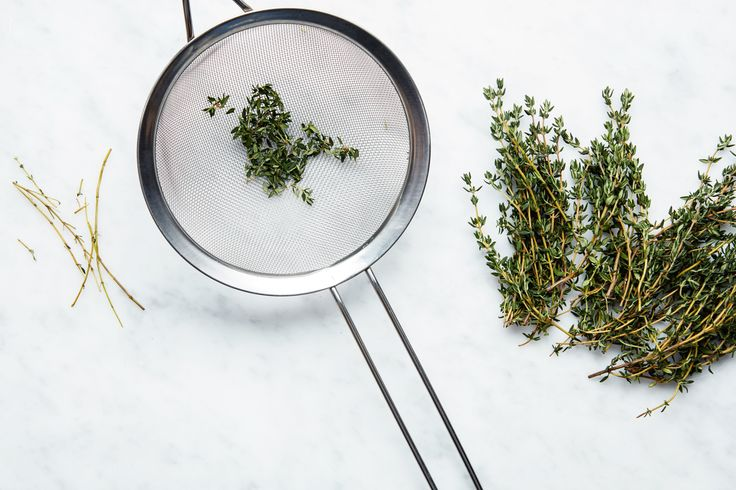 A simple trick, using a strainer, for removing thyme, rosemary, sage, and lavender leaves.
